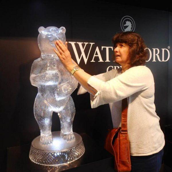 Carleeta touching a huge Waterford Crystal bear.