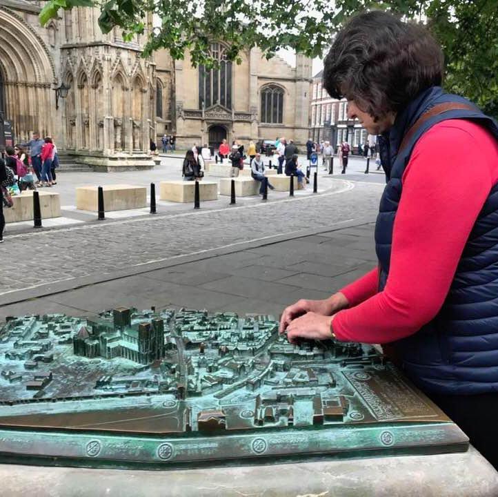 Carleeta touching a tactile map of York.