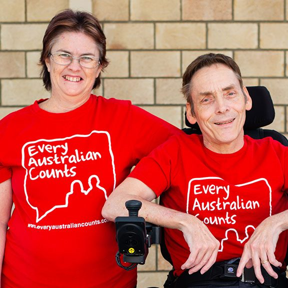 Linda and Peter Tully wearing bright red Every Australian Counts teeshirts